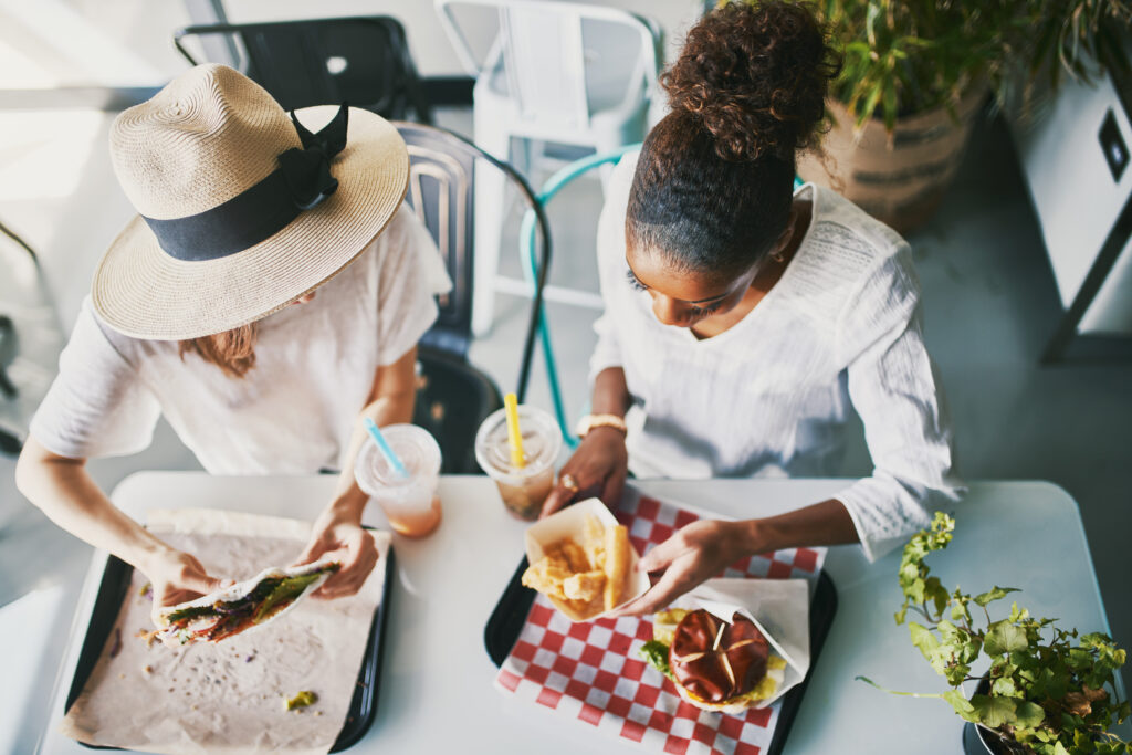 Diners eating plant-based food at a restaurant
